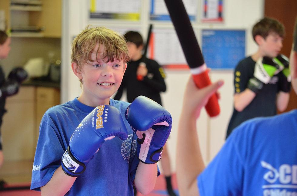 Children practicing boxing head movement drills
