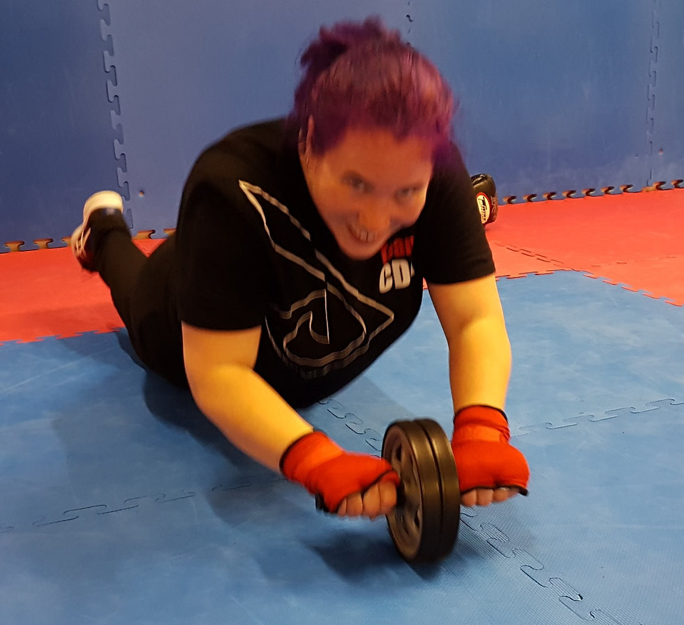 Woman getting fit using an ab wheel