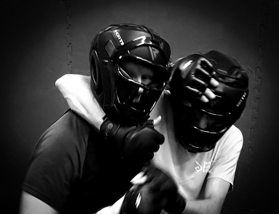 Image of two masked sudents in a grappling position during self defence class