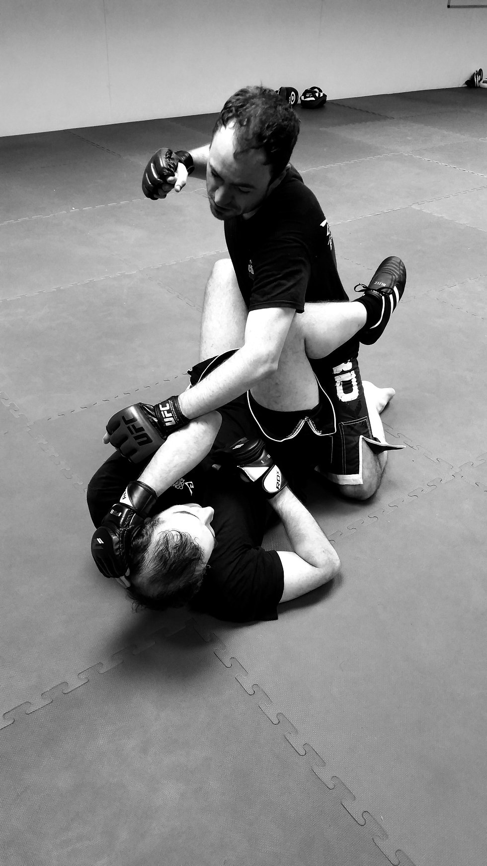 Two students practcing ground fighting in guard position