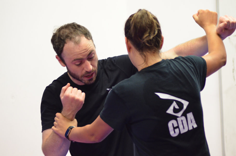 Two students in a self defence grapple