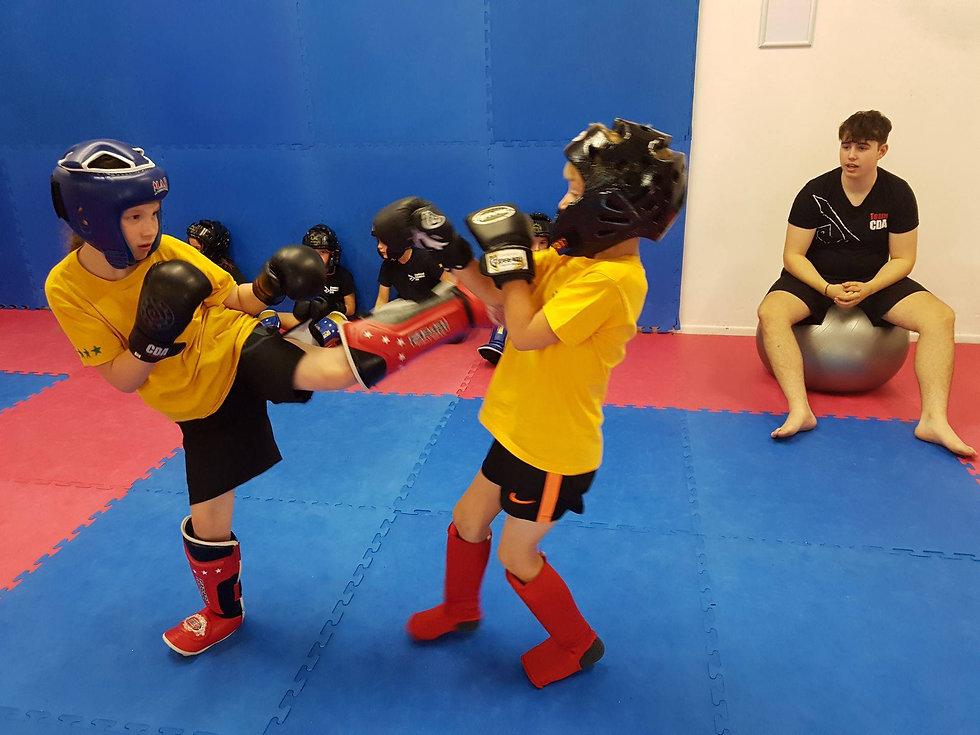 Two Children kickboxing sparrig