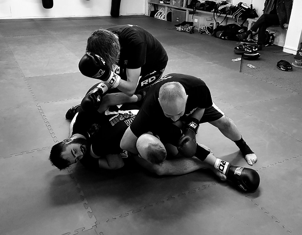 One student fighting 3 attacker in a multiple attacker self defence class