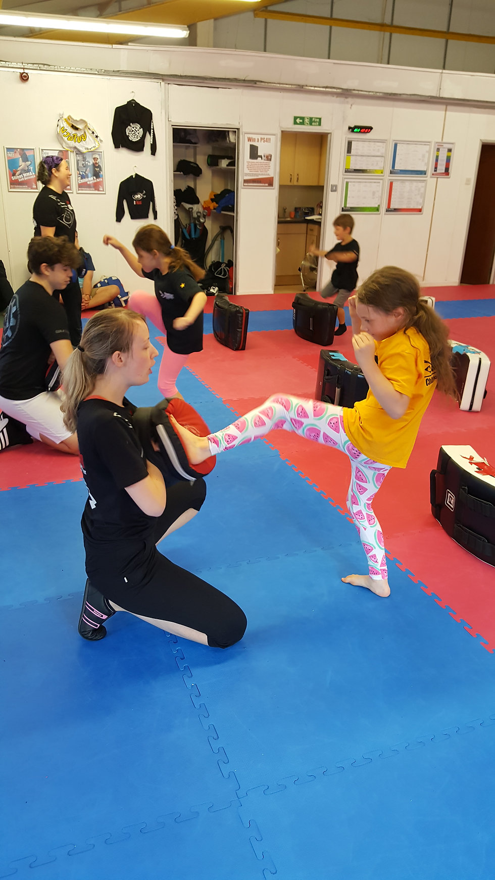 One of our instructors teaching a front kick to a child student