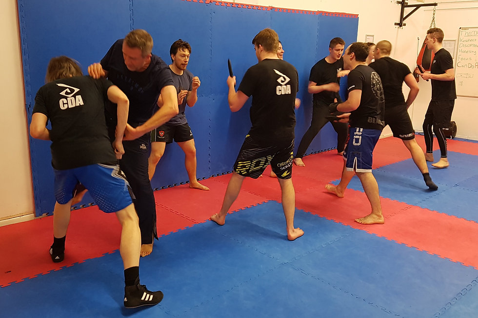 Group of students in a knife defence class