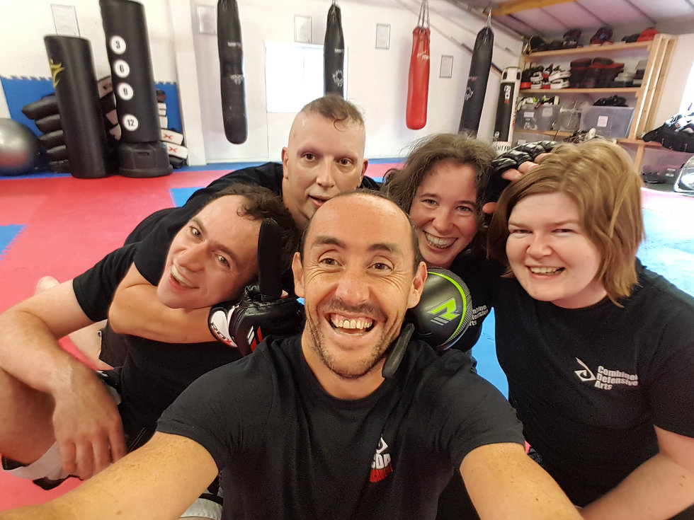 Some of the CDA staff in a group photo after a self defence seminar