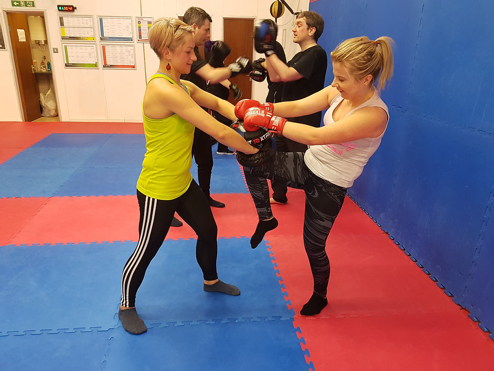 image of ladies kickboxing in a fitness class