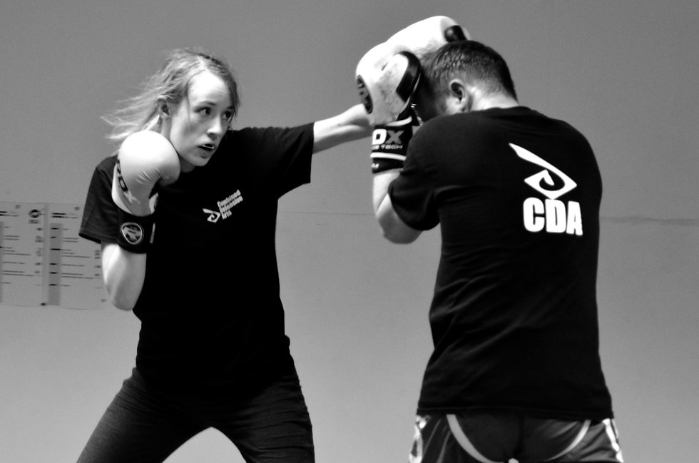 Female Kickboxing student throwing a left jab punch