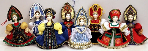 A RANGE OF HANGING DOLLS IN THE RUSSIAN COSTUMES