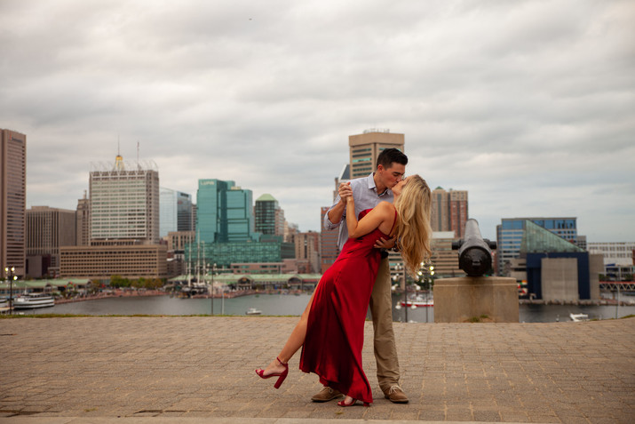Dip kiss engagement session at Fed Hill in Baltimore Inner Harbor