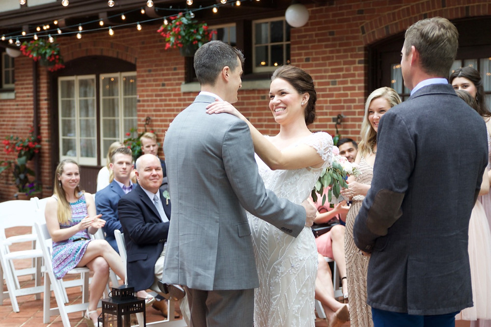 Bride and groom have glowing smiles after first kiss