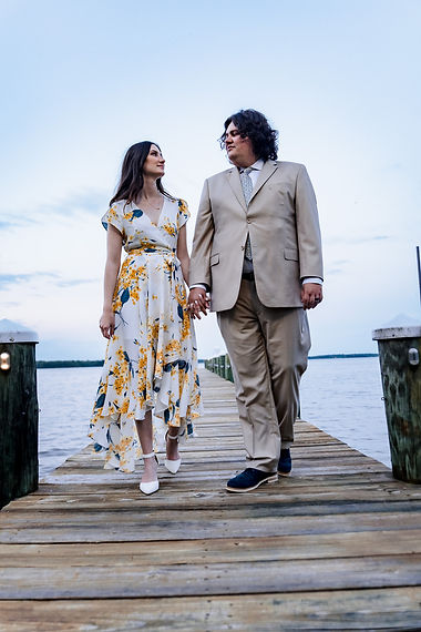 Newly weds in Chase Maryland walking on a dock