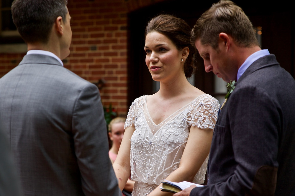 Bride gives her vows to the groom as the officiant recites them at Gramercy mansion in Maryland