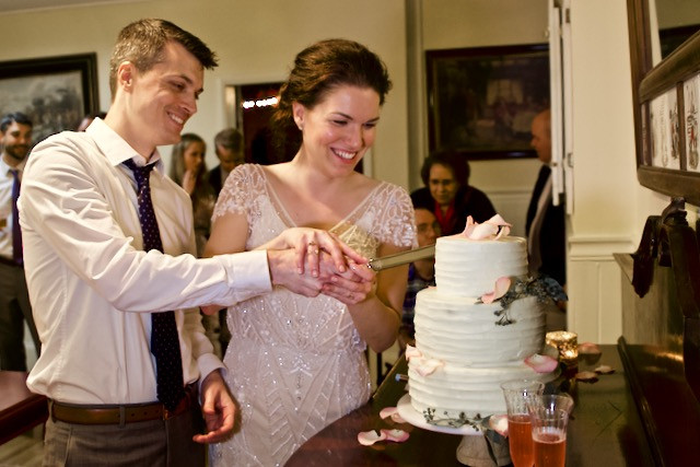 Bride and groom cut their wedding cake at Gramercy Mansion in Maryland