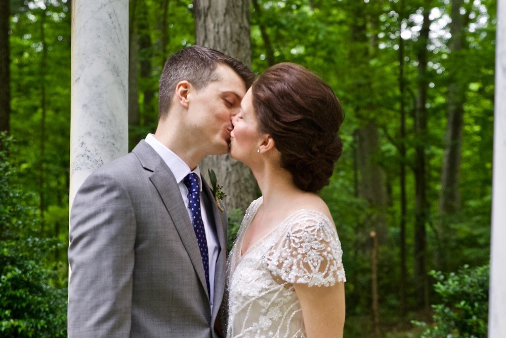 Bride and groom kiss in the gazebo at Gramercy Mansion in Maryland