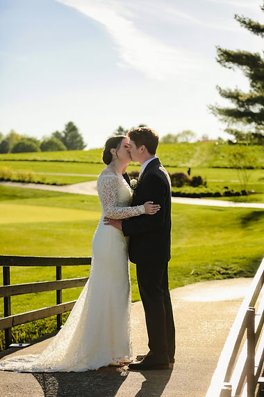 Newlyweds kiss at Piney Branch Golf Club in Upperco, Maryland