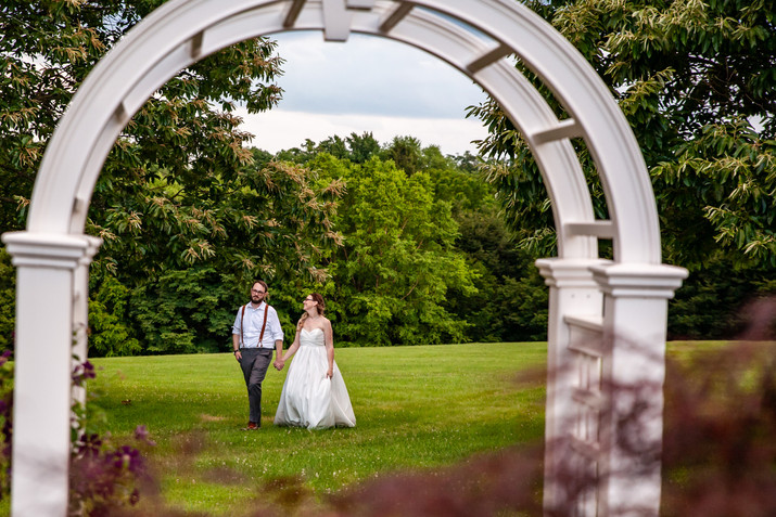 Bride and groom walk together at Rockfield Manor