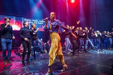 Norway - Dee walking performing on stage