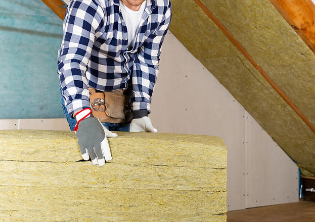Man%20installing%20thermal%20roof%20insulation%20layer%20-%20using%20mineral%20wool%20panels_edited.