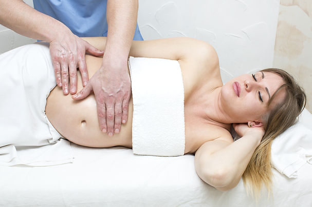 pregnancy massage relaxing pain tension relief reduce swelling
