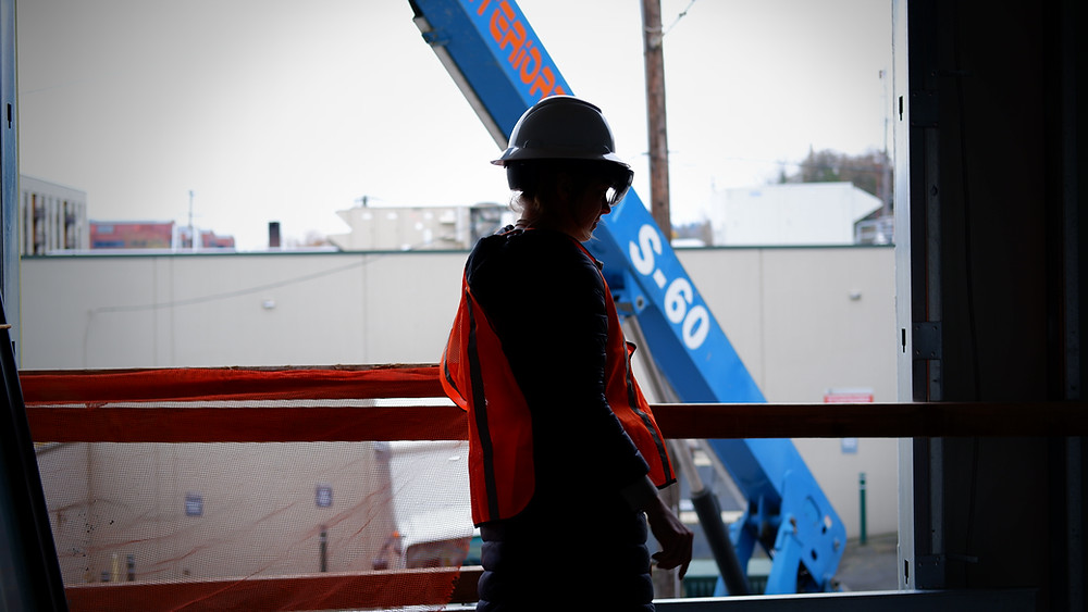 Woman in Construction wearing Personal Protective Equipment and a Hololens 2