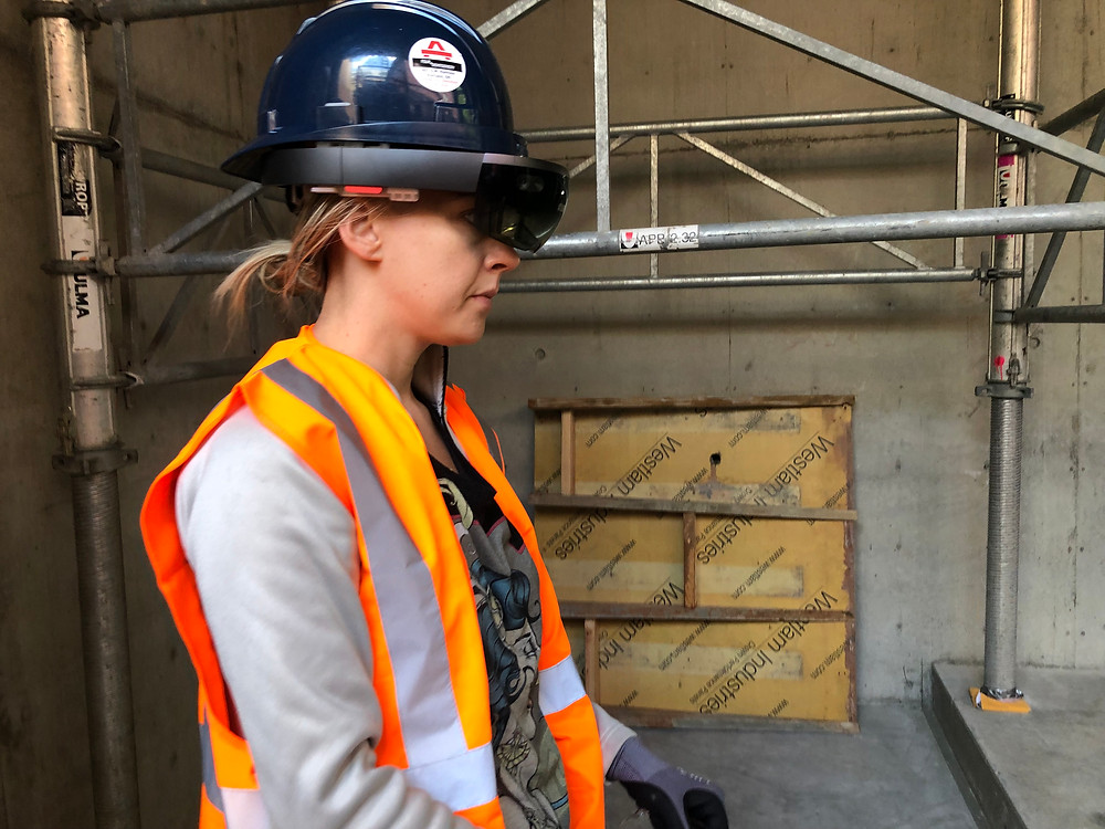 Maret is wearing a hololens on a construction site.