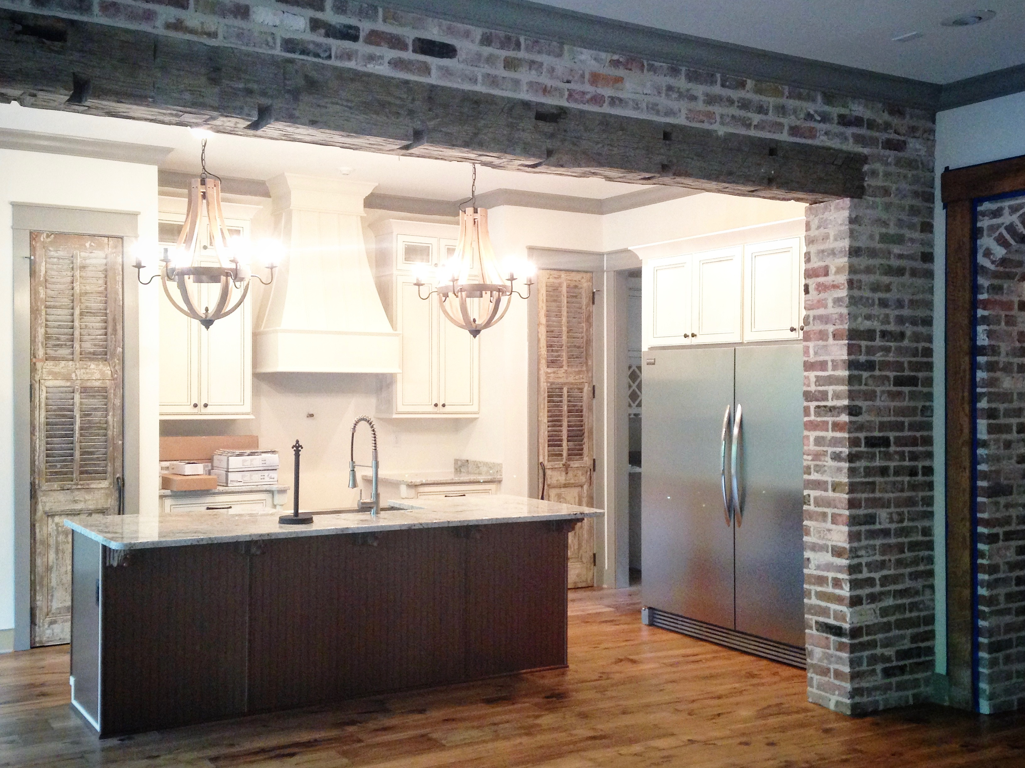 Kitchen Design Paired Antique Doors Custom Range Hood Starkville Verde Construction