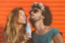 Hipster couple drinking milk from bottle