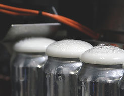 foam caps on canned beer