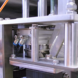 Lid applicator on a CODI craft canning system