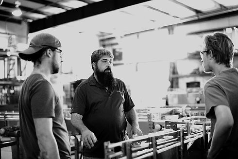Technicians talking about canning machines