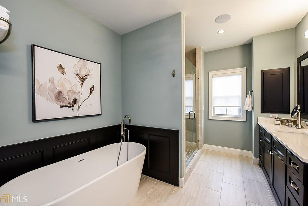 Use large wall art when staging the bathroom