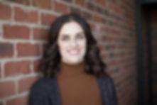 brunette smiling chiropractor