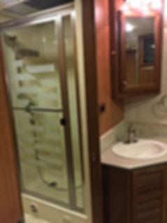 old shower, counter, facet and sink