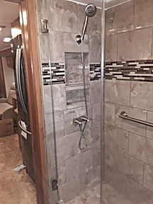 Custom tile shower with niche