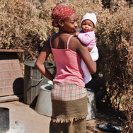 Beautiful Botswana mother carring baby.jpg