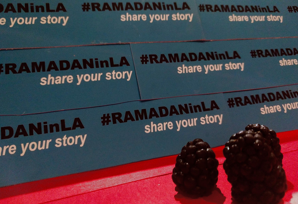 Two blackberries amble down the red carpet in front of a #RAMADANinLA step and repeat.