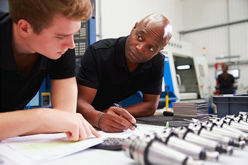 Engineer And Apprentice Planning CNC Mac