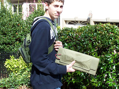 teenage boy with portable solar panel and back pack