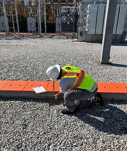 african american male engineer taking measurments