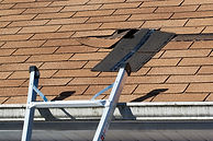 Fixing damaged roof shingles.  A section