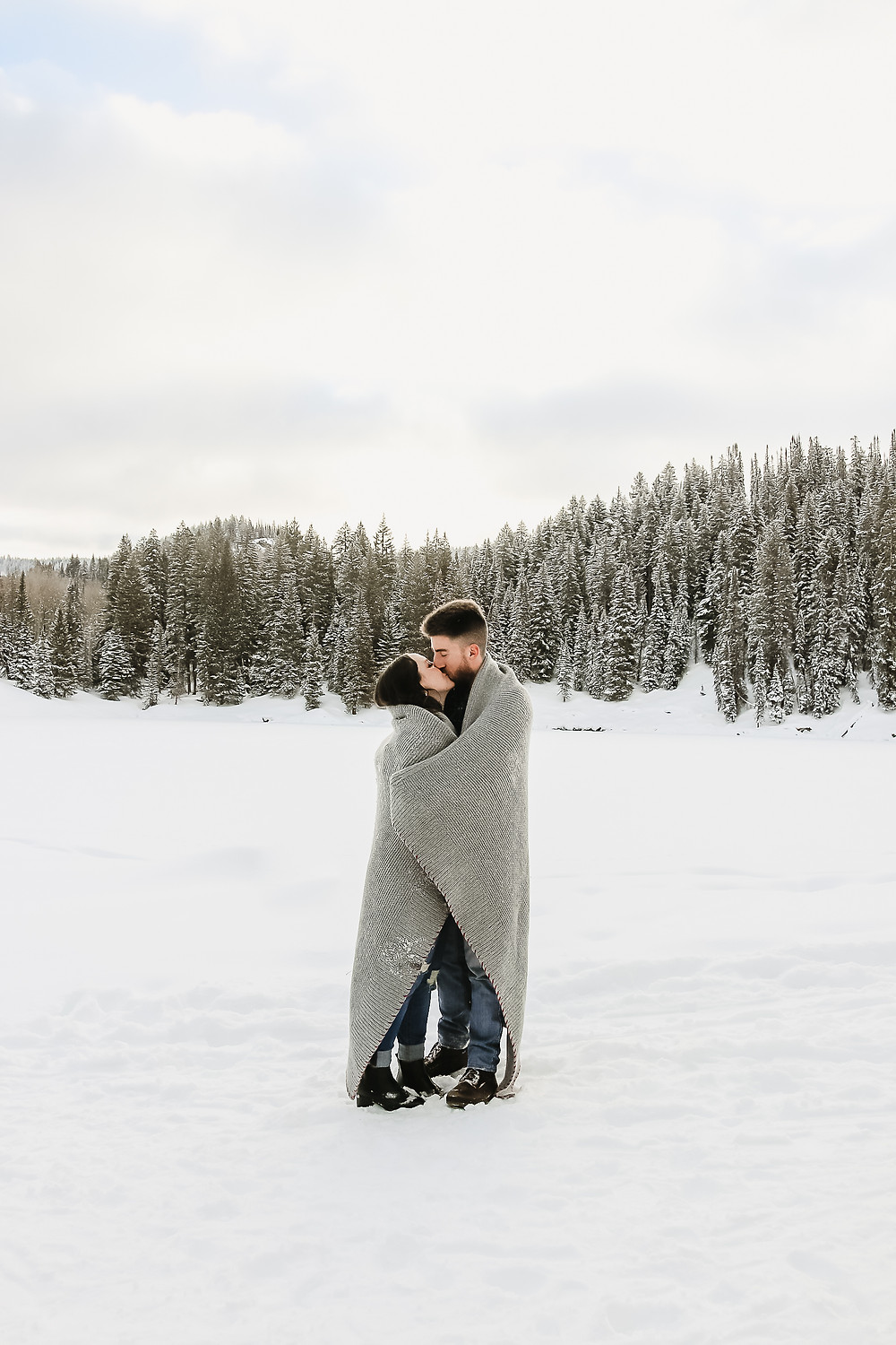 Snowy engagement photos Colorado mountains Mesa Lakes Lodge winter