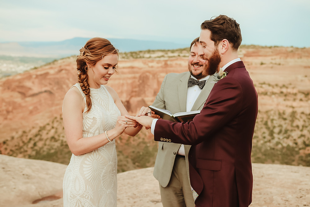 Colorado National Monument intimate elopement bride and groom elope desert scenery Bookcliff Overlook ceremony ring exchange