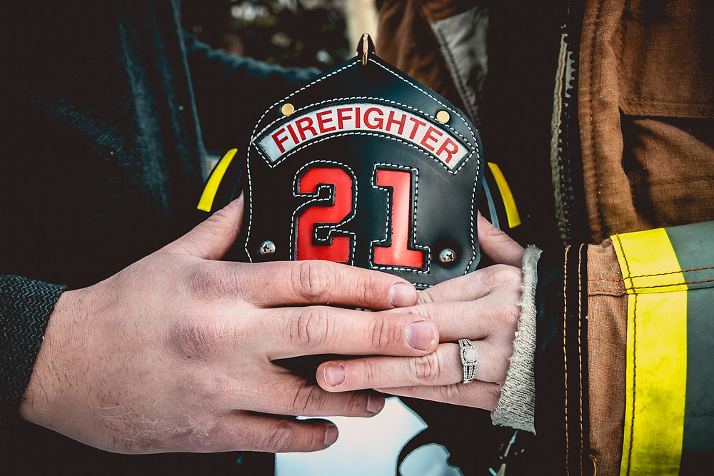 Firefighter engagement photos winter snow Colorado mountains Grand Mesa Lakes Lodge