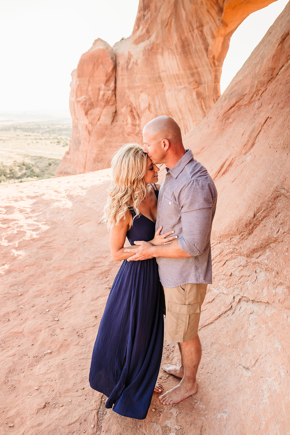 Moab Utah Wilson Arch romantic engagement navy maxi dress what to wear