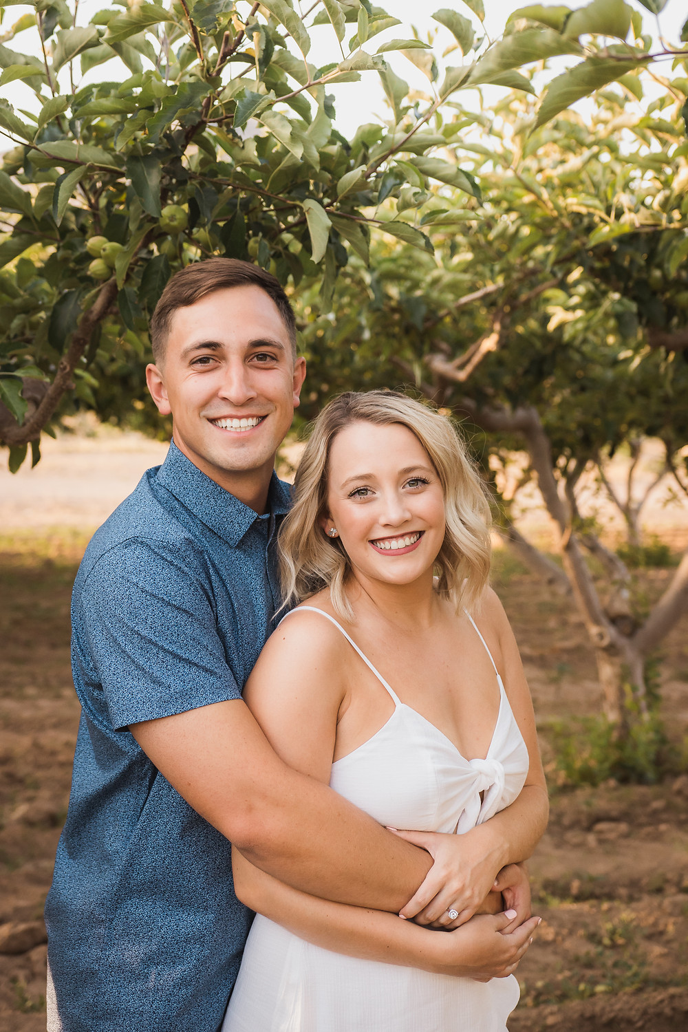 Palisade Colorado peach orchard trees summer golden hour engagement photos