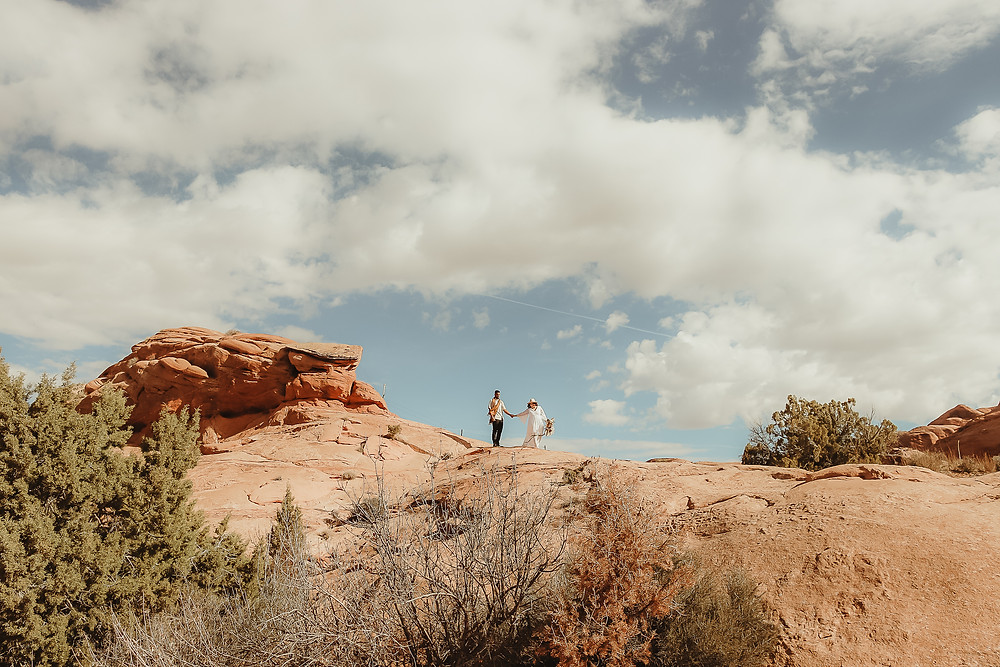 Moab Utah elopement couple bride and groom red rocks desert eloping Colorado photographer