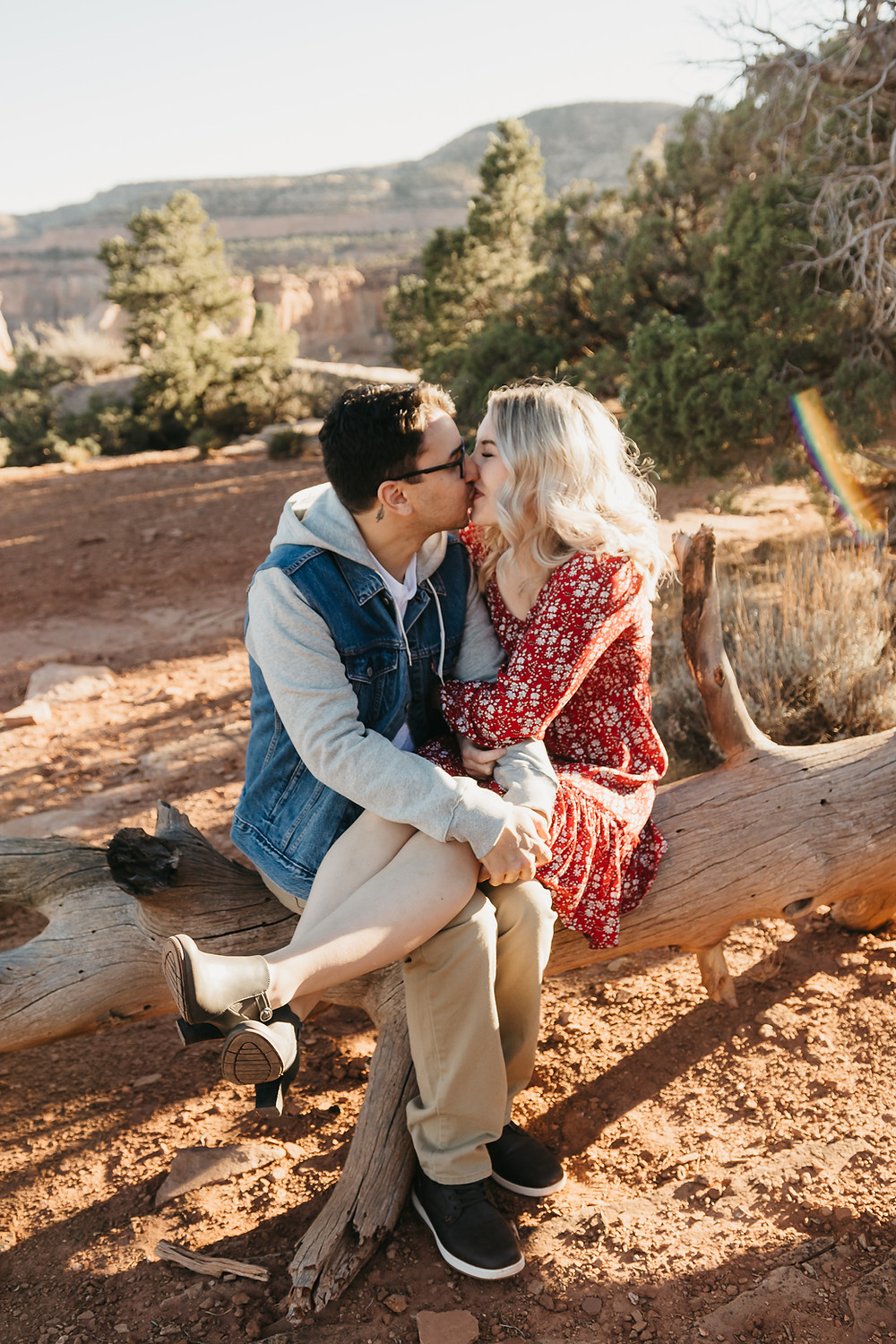 Beautiful engaged couple kissing on Colorado National Monument Grand Junction Colorado engagement photos
