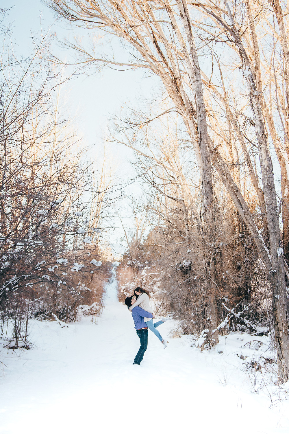 Winter engagement photos Colorado mountains Ridgway State Park Telluride snowy trees