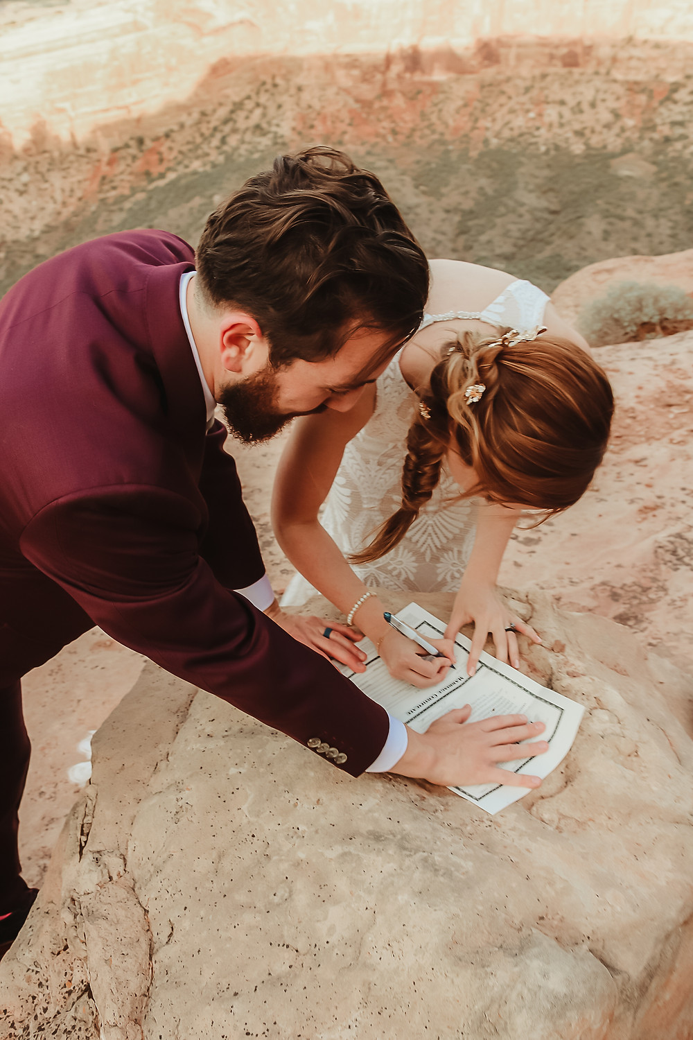 Colorado National Monument intimate elopement bride and groom elope desert scenery Bookcliff Overlook sign marriage license